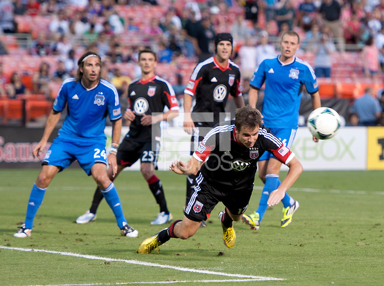 Conor Shanosky (17) of D.C. United heads the ball out of the box during a Major League Soccer game at RFK Stadium in Washington, DC.  D.C. United defeated San Jose Earthquakes, 1-0.