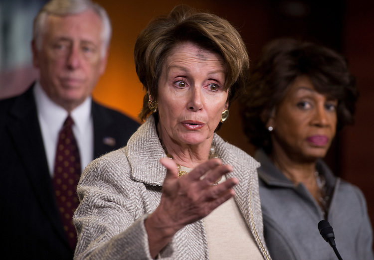 UNITED STATES - FEBRUARY 13: From left, House Minority Whip Steny Hoyer, D-Md., House Minority Leader Nancy Pelosi, D-Calif., and Rep. Maxine Waters, D-Calif., conduct a news conference in the Capitol Visitor Center on the reauthorization of the Violence Against Women Act.  (Photo By Tom Williams/CQ Roll Call)