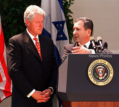 Washington, DC - July 15, 1999 - New Prime Minister Ehud Barak of Israel makes a point as United States President Bill Clinton looks on at a press availability in the Rose Garden at the White House on Thursday, 15 July, 1999..Credit: Ron Sachs / CNP