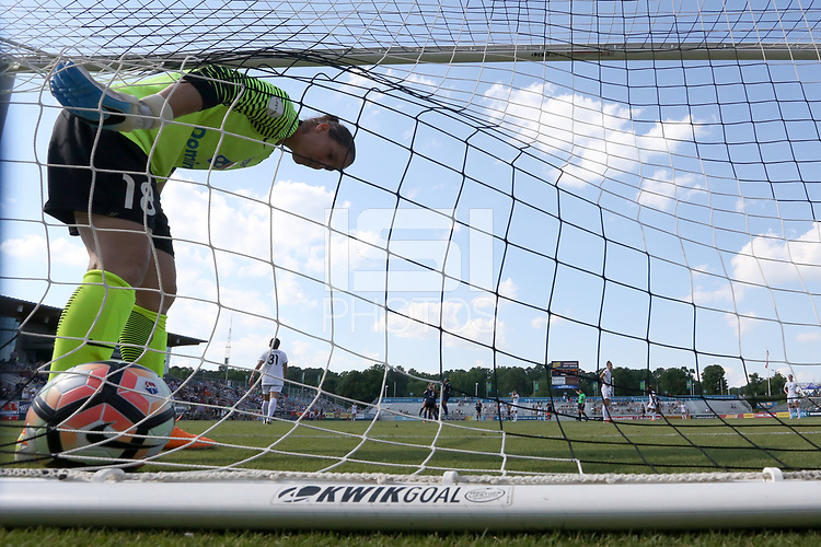 Cary, North Carolina  - Saturday June 03, 2017: Nicole Barnhart fishes the ball out of the net after giving up a goal to Ashley Hatch (not pictured) during a regular season National Women's Soccer League (NWSL) match between the North Carolina Courage and the FC Kansas City at Sahlen's Stadium at WakeMed Soccer Park. The Courage won the game 2-0.