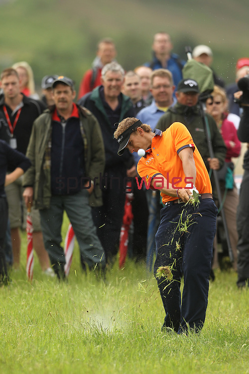 Joost Luiten hits the ball out of heavy rough on the 2nd hole on day 4 of the ISPS Handa Wales Open 2012..03.06.12.©Steve Pope