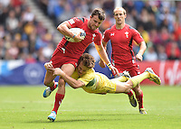 Wales's Luke Morgan is tackled by Australia's Con Foley<br /> <br /> Australia Vs Wales - Men's quarter-final<br /> <br /> Photographer Chris Vaughan/CameraSport<br /> <br /> 20th Commonwealth Games - Day 4 - Sunday 27th July 2014 - Rugby Sevens - Ibrox Stadium - Glasgow - UK<br /> <br /> © CameraSport - 43 Linden Ave. Countesthorpe. Leicester. England. LE8 5PG - Tel: +44 (0) 116 277 4147 - admin@camerasport.com - www.camerasport.com