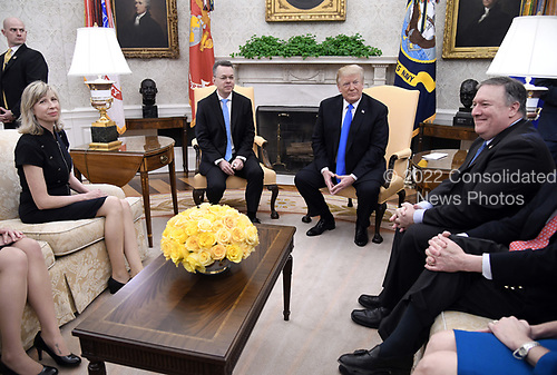U.S. President Donald Trump meets with Pastor Andrew Brunson as his wife Norine Brunson (L) and Secretary of State Mike Pompeo (R) look on in the Oval Office of the White House on October 13, 2018 in Washington, DC. Pastor Andrew Brunson arrived back in the U.S. on Saturday after being held in Turkey for two years on terrorism charges. <br /> Credit: Olivier Douliery / Pool via CNP