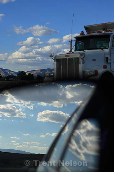 clouds, rear-view mirror, truck passing. &amp;#xA;; 8.17.2006<br />