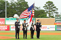 The color guard prior to the Appalachian League game between the Danville Braves and the Burlington Royals at Burlington Athletic Park on July 18, 2012 in Burlington, North Carolina.  The Royals defeated the Braves 4-3 in 11 innings.  (Brian Westerholt/Four Seam Images)