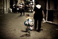 A child carries a balloon in Naples, Italy...PHOTOS/ MATT NAGER