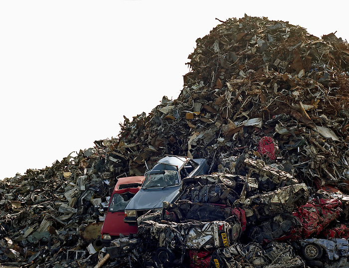 A pile of scrap metal, containing many cars.england 2002.