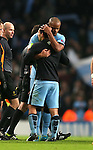 Captain Vincent Kompany of Manchester City hugs goalscorer Sergio Aguero of Manchester City - UEFA Champions League group E - Manchester City vs Bayern Munich - Etihad Stadium - Manchester - England - 25rd November 2014  - Picture Simon Bellis/Sportimage