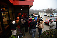 A line of people begins to enter the main door Saturday, Jan. 11, 2020, at the Arby's restaurant on Martin Luther King Jr. Boulevard in Fayetteville as they vie to win free food for a year. Nine restaurants in Bentonville, Rogers, Lowell, Springdale, Fayetteville, and Siloam Springs celebrated the completion of their remodeling with a customer appreciation day, offering free food for the first 25 patrons present at each location's opening as well as $1 sandwiches all day. First in line was Abud Metwally, a MFA student at the University of Arkansas from Egypt, who arrived at dawn. Check out nwaonline.com/200112Daily for today's photo gallery. (NWA Democrat-Gazette/Andy Shupe)