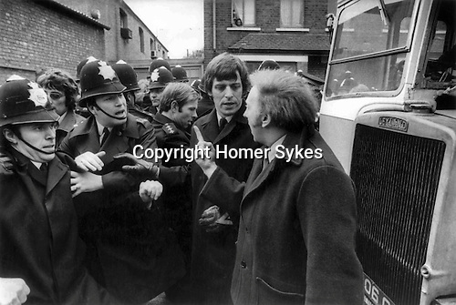 Willisden, London. 1977<br /> Arthur Scargill, the president of the National Union of Miners, Yorkshire branch having words with the police. He attended the mass-picket in a show of solidarity with a delegation of miners from as far a field as Yorkshire, South Wales and Kent.