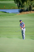 Rickie Fowler (USA) chips on to 5 during round 1 foursomes of the 2017 President's Cup, Liberty National Golf Club, Jersey City, New Jersey, USA. 9/28/2017.<br /> Picture: Golffile | Ken Murray<br /> ll photo usage must carry mandatory copyright credit (&copy; Golffile | Ken Murray)