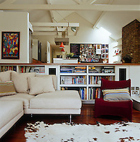 """The 'passion pit"""" is a sunken seating area furnished with a cowskin rug and modern Italian sofas"""