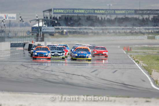 Tooele - Cars approach Sunset Bend at the start of the Nascar Camping World Series Saturday, August 1 at Miller Motorsports Park..