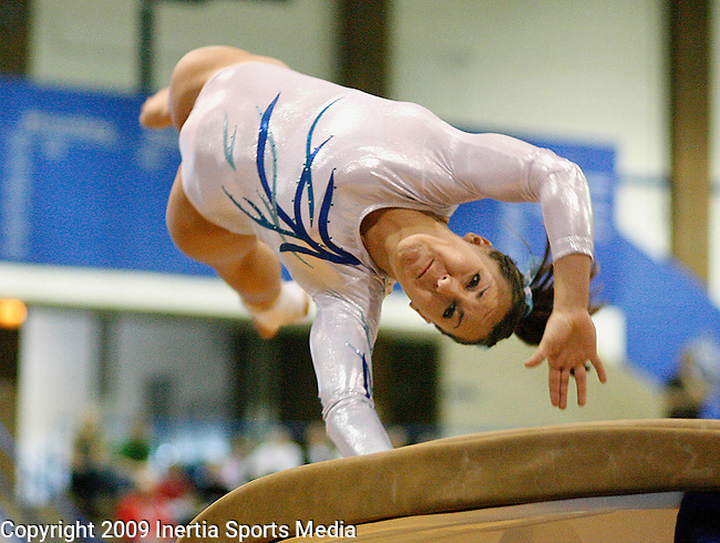 RAPID CITY, SD - FEBRUARY 21, 2009 --  Kaitlin Lang of Sioux Falls Lincoln hits the vault table during the 2009 South Dakota State Gymnastics meet Saturday at Carold Heier Gymnasium at Rapid City Stevens High School. (Photo by Dick Carlson/Inertia)