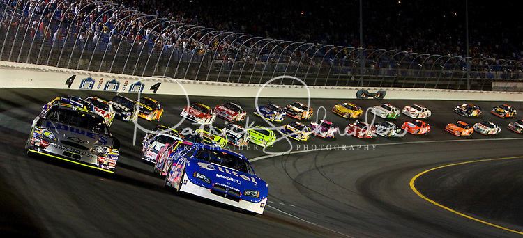 Cars make their way through turn four during the Bank of America 500 NASCAR race at Lowes's Motor Speedway in Concord, NC.