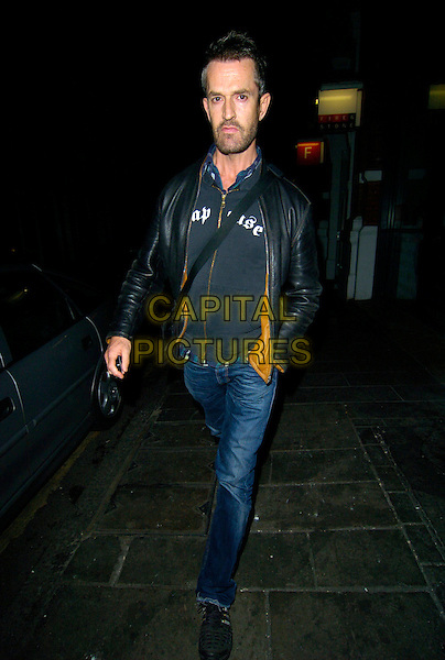 "RUPERT EVERETT.The ""Rent"" Press night afterparty at Jewell Bar, Covent Garden, London, England..October 15th, 2007.full length jeans denim black leather jacket walking hand in pocket beard stubble facial hair .CAP/CAN.©Can Nguyen/Capital Pictures"