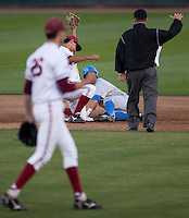 STANFORD, CA - April 21, 2011: Mark Appel of Stanford baseball pumps his fist after Kenny Diekroeger shows the out on an attempted UCLA steal during Stanford's game against UCLA at Sunken Diamond. Stanford won 7-4.