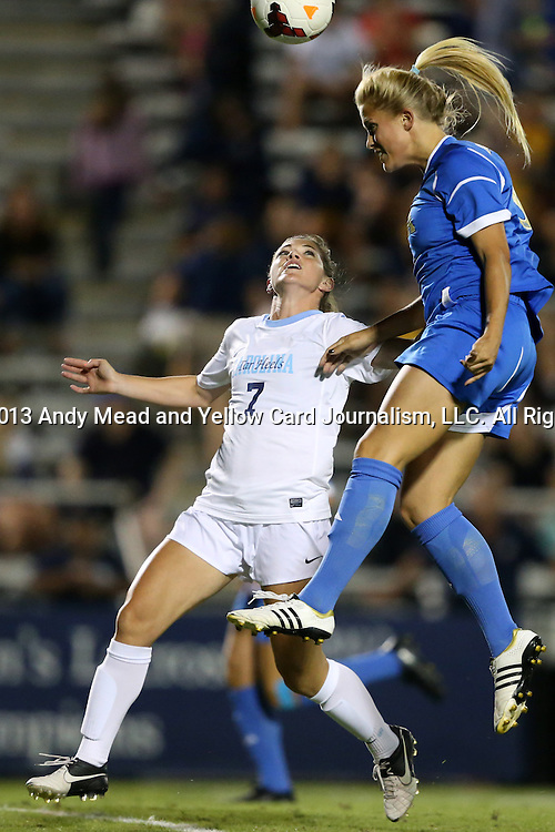 06 September 2013: UCLA's Abby Dahlkemper (right) and North Carolina's Kealia Ohai (7). The University of North Carolina Tar Heels played the University of California Los Angeles Bruins at Koskinen Stadium in Durham, NC in a 2013 NCAA Division I Women's Soccer match. UNC won the game 1-0.
