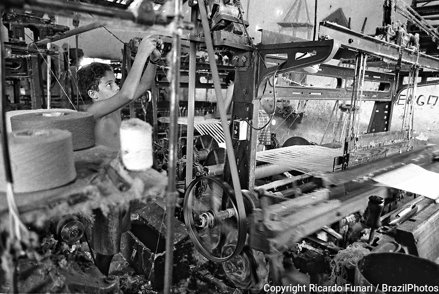 Child labor at backyard fabric factory in Jardim de Piranhas city, Rio Grande do Norte State, northeastern Brazil. No PPE, no personal protective equipment.