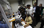 Deputy Qatari Ambassador Khaled Hardan visits a Post Office as Palestinian employees of Gaza strip wait to receive their salaries, in Gaza city, on November 9, 2018. Officials in Gaza said that NIS 90 million in funds from Qatar were transferred to the territory. Government employees receive their salaries for the month of August on Friday. Their salaries for September and October are to be paid soon as well. The Qatari funds are for civilian employees only and not security services. Photo by Mahmoud Ajour
