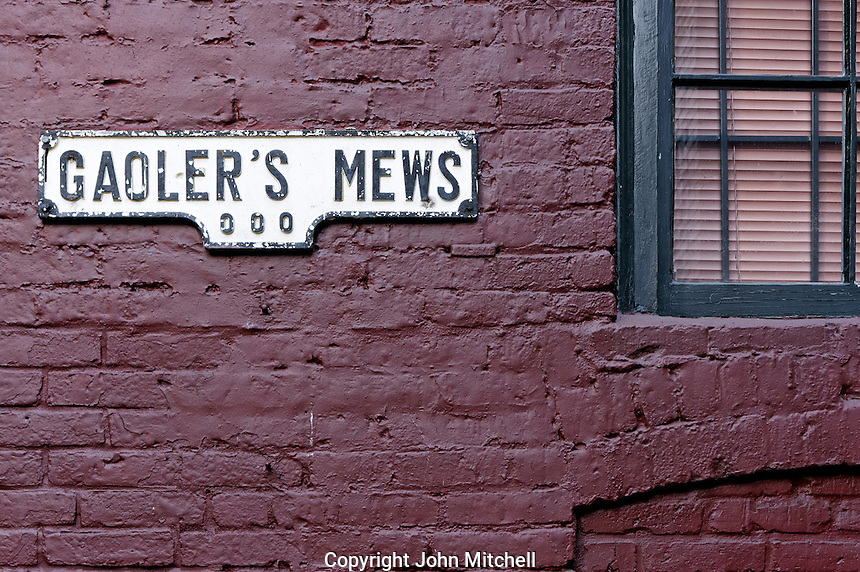 Gaeoler's Mews alley sign on a painted brick wall in the historical Gastown district, Vancouver, BC, Canada