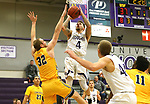 SIOUX FALLS, SD - DECEMBER 7: Trevon Evans #4 from the University of Sioux Falls shoots over Max Keefe #32 from Concordia St. Paul during their game Friday night at the Stewart Center in Sioux Falls, SD. (Photo by Dave Eggen/Inertia)