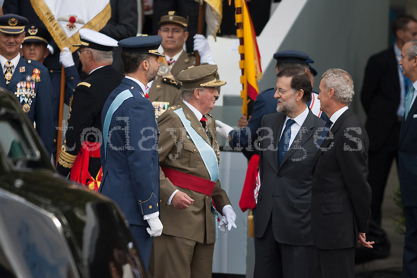 Primer Minister Mariano Rajoy speaks with King Juan Carlos I