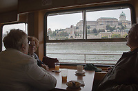 Participants enjoy a boat ride on river Danube with the Castle of Buda in the background during the International Day for Older Persons in Budapest, Hungary on Oct. 1, 2018. ATTILA VOLGYI