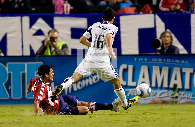 Ante Jazic Chivas USA defender tackles Chicago Fire midfielder Marco Pappa. The Chicago Fire defeated CD Chivas USA 3-1 at Home Depot Center stadium in Carson, California on Saturday October 23, 2010.