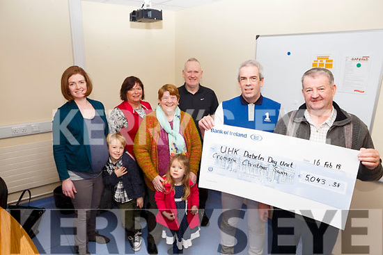 HK Diabetes Unit cheque presentation of &euro;5,043.38 from the Cromane Christmas Swim by the O&rsquo;Shea family in memory of their son Denis.<br /> James O&rsquo;Shea handing the cheque over to Dr. Tom Higgins (Consultant UHK).<br /> In the back l-r, Roisin, Paudie and Reiltin O&rsquo;Shea, Helen Crowley (Diabetes Nurse), Kathleen O&rsquo;Shea and Shane Flynn (Diabetes Nurse).