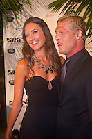"GOLD COAST, Queensland/Australia (Thursday, February 24, 2011) Mick Fanning (AUS) and his wife Karrisa.   -The ASP World Surfing Awards was held  tonight at the Gold Coast Convention and Exhibition Centre. .Surfing's ""night of nights"", the ASP World Surfing Awards, was a gala event, hosting the world's best surfers as well as distinguished figures from the surfing industry to honor of the 2010 ASP World Champions.. .Kelly Slater (USA), 39,  accepted his history-making and unprecedented tenth ASP World Title just a day before opening his 2011 ASP World Title campaign at the Quiksilver Pro Gold Coast.  .Stephanie Gilmore (AUS), 23,  made her own history ton the  evening, collecting her fourth consecutive Women's World Title. Gilmore will begin her 2011 assault this weekend at the opening event of the 2011 ASP Women's World Title season, the Roxy Pro Gold Coast.. .Slater and Gilmore headlined a slew of incredible athletes on the evening.. .Awards Recipient List:. .2010 ASP World Champion:Kelly Slater (USA).2010 ASP Women's World Champion:Stephanie Gilmore (AUS). .2010 ASP World Tour Runner-Up:Jordy Smith (ZAF).2010 ASP Women's World Tour Runner-Up:Sally Fitzgibbons (AUS). .2010 ASP World Tour Rookie of the Year: Owen Wright (AUS).2010 ASP Women's World Tour Rookie of the Year:Carissa Moore (HAW. .2010 ASP World Tour 'Breakthrough Performer':TBA.2010 ASP Women's World Tour 'Breakthrough Performer':TBA. .2010 ASP World Longboard Champion:Duane DeSoto (HAW).2010 ASP Women's World Longboard Champion:Cori Schumacher (HAW). .2010 ASP World Junior Champion:Jack Freestone (AUS).2010 ASP Women's World Junior Champion:Alizee Arnaud (FRA). .Photo: joliphotos.com"
