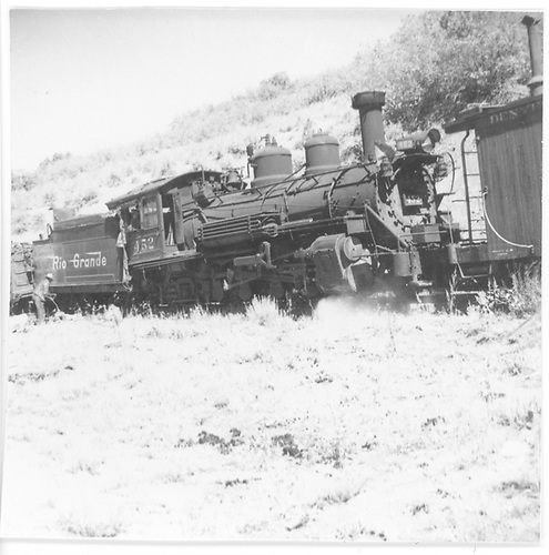 3/4 engineer's-side view of derailed leased D&amp;RGW #452 between a D&amp;RGW caboose and a gondola.  Other photos of this event are in both &quot;The Rio Grande Southern Story&quot; and &quot;The Rio Grande Southern Railroad&quot; showing Thomas as the photographer could be in error as Mrs. Crum sometimes failed to differentiate between a photographer and a photo source.<br /> RGS  Mule Shoe Curve, CO  Taken by Thomas, Charles H. - 1946