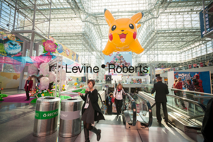 Pokemon balloon suspended over attendees at the 114th North American International Toy Fair in the Jacob Javits Convention center in New York on Sunday, February 19, 2017.  The four day trade show with over 1000 exhibitors connects buyers and sellers and draws tens of thousands of attendees.  The toy industry generates over $26 billion in the U.S. alone and Toy Fair is the largest toy trade show in the Western Hemisphere. (© Richard B. Levine)
