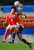 Hyun Young Lee (KOR) and Olivia Klei (USA) compete for the ball..FIFA U17 Women's World Cup, USA v Korea Republic, Waikato Stadium, Hamilton, New Zealand, Sunday 9 November 2008. Photo: Renee McKay/PHOTOSPORT