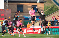Goalkeeper Adam Smith of Northampton Town punches clear of danger during the Sky Bet League 2 match between Wycombe Wanderers and Northampton Town at Adams Park, High Wycombe, England on 3 October 2015. Photo by Andy Rowland.