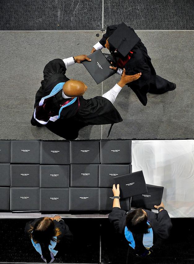 Sparkman High School principal Manuel Wallace passes out diplomas.  Sparkman High School graduation at Von Braun Center arena June 2009.    Bob Gathany photo.