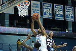 14 November 2012: North Carolina's Xylina McDaniel (34) grabs a rebound against Georgetown's Brittany Horne (33). The University of North Carolina Tar Heels played the Georgetown University Hoyas at Carmichael Arena in Chapel Hill, North Carolina in an NCAA Division I Women's Basketball game, and a semifinal in the Preseason WNIT. UNC won the game 63-48.