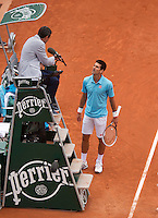 France, Paris, 30.05.2014. Tennis, French Open, Roland Garros, Novak Djokovic (SRB) arguing with the umpire in his match against Marin Cilic (CRO) <br /> Photo:Tennisimages/Henk Koster