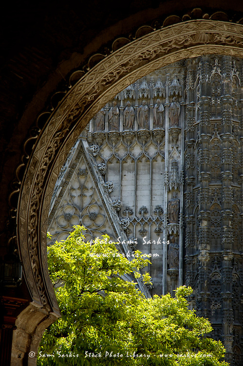 Seville Cathedral seen from beneath the portal of El Perdon, Seville, Andalusia, Spain.