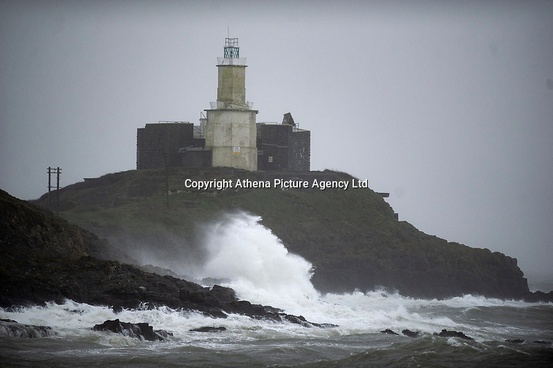 Pictured: Waves crash into a rocks in Bracelet Bay, Mumbles, Swansea Wales, UK. Friday 08 February 2019<br /> Re: Strong winds affect parts of Wales and the rest of the UK.