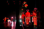 Hundreds of people come together to participate in a performance for Chinese New Year, at the Fred Kavli Theater in Thousand Oaks, Calif., on Saturday, Feb. 18th, 2012. This year is year is the year of the Dragon. Performers wait to enter the stage during the show.