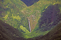 Beautiful Moaula Falls in isolated Halawa Valley, east Molokai, falling an estimated 250 feet from the lush green mountains.