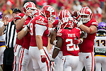 Wisconsin Badgers running back James White (20) celebrates a touchdown with his teammates during an NCAA football game against the Tennessee Tech Golden Eagles  Saturday, September 7, 2013, in Madison, Wis. (Photo by David Stluka)