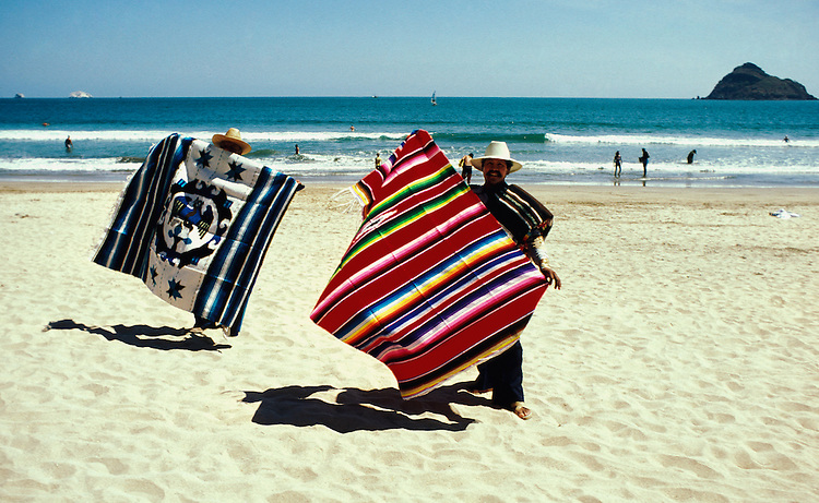 Mexico: Mazatlan beach..Blanket sellers. .Photo copyright Lee Foster, www.fostertravel.com. .Photo #: mxmaza102, 510/549-2202, lee@fostertravel.com