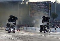 Mar 15, 2014; Gainesville, FL, USA; NHRA top fuel dragster driver Doug Kalitta (left) alongside Bob Vandergriff during qualifying for the Gatornationals at Gainesville Raceway Mandatory Credit: Mark J. Rebilas-USA TODAY Sports