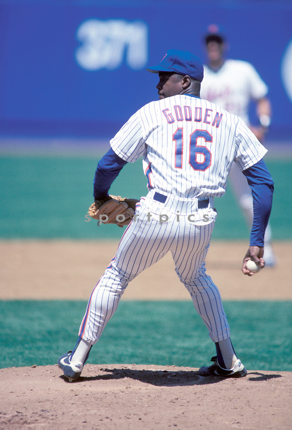 New York Mets Dwight Gooden (16)  in action during a game from the 1990 season with the New York Mets at Shea Stadium in Flushing Meadows, New York. Dwight Gooden played for 16 years all with 5 different teams.