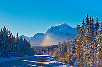 Partial rainbow idown the Icefields Parkway n the Canadian Rocky Mountains, Banff National Park, Alberta, Canada