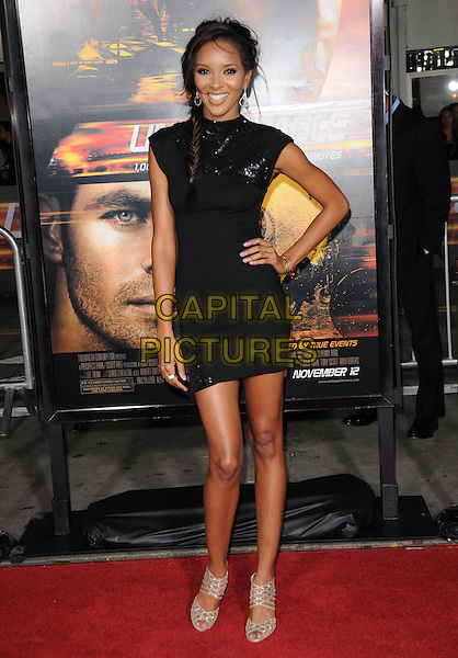 "ELIZABETH MATHIS .attends the Twentieth Century Fox's L.A. Premiere of ""Unstoppable"" held at Regency Village Theater in Westwood, California, USA, October 26th 2010..full length black dress hand on hip beige open peep toe shoes cut out  sequined sequin polo neck smiling plait hair braid .CAP/RKE/DVS.©DVS/RockinExposures/Capital Pictures."