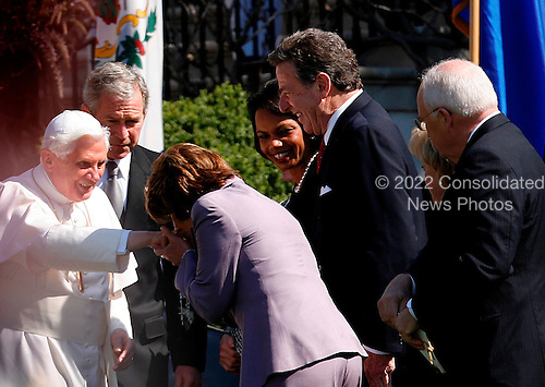 House Speaker Nancy Pelosi is kissing the pope's hand before the Arrival Ceremony hosted by the president and Mrs Bush in the South Lawn of the  White House, Washington DC, April 16, 2008. (l-r) The Pope, President Bush, Nancy Pelosi, Secretary of States Condoleezza Rice, Paul Pelosi, Mr and Mrs Dick Cheney..