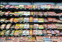 Packages of various brands of hot dogs are seen in a supermarket cooler in New York on Thursday, April 7, 2016. (© Richard B. Levine)